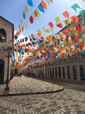 Beautiful and colorful flags at city center of Sao Luis: Brazil. Beautiful and colorful flags between historical buildings at city center of Sao Luis: Brazil royalty free stock images