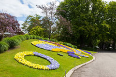Beautiful and colorful floral clock in geneva switzerland - Swis. S horology symbol Stock Photos