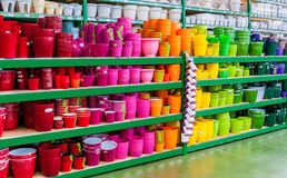 Beautiful colorful flower pots on the shelves of a shop of garden household goods Stock Images