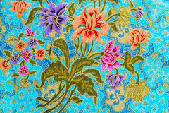 Beautiful colorful flowers on batik background Stock Photography