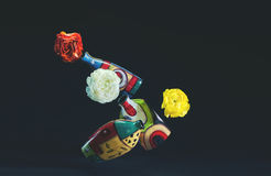 Beautiful colorful flowers and levitating colored vases. Royalty Free Stock Image