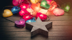 Beautiful colorful heart shaped garland and star shaped toy lyin Royalty Free Stock Image