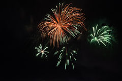 Beautiful colorful holiday fireworks on the black sky background, long exposure Stock Photos