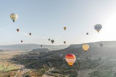 beautiful colorful hot air balloons flying above cappadocia, turkey royalty free stock image