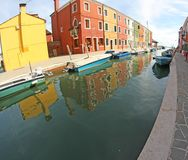 Beautiful colorful houses on the island of BURANO and a canal Stock Images