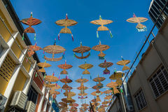The beautiful and colorful kites hanged the middle of the buildings Royalty Free Stock Photos
