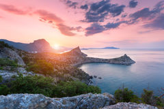 Beautiful colorful landscape. Sunrise in mountains at the sea Royalty Free Stock Image