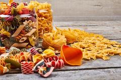 Beautiful colorful macaroni in different shapes. Royalty Free Stock Images
