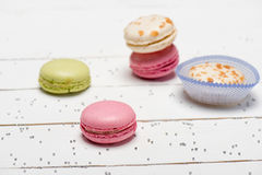 Beautiful colorful macarons on white wooden table. stock photo