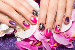 Beautiful colorful manicure with bubbles and. Crystals on female hand. Close-up. Picture taken in the studio Stock Images