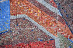 Beautiful colorful mosaic of square elements on the wall. Beautiful colorful mosaic of different square elements on the wall royalty free stock photo