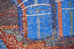 Beautiful colorful mosaic of square elements on the wall. Beautiful colorful mosaic of different square elements on the wall royalty free stock images