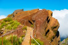 Colorful mountain ridge path with volcanic formations beside, Pico do Arieiro, Madeira, Portugal stock image