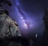 Beautiful colorful night landscape with Milky Way, rocks, sea and starry sky. Mountain landscape. Amazing universe. Stock Image