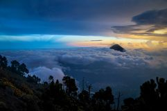 Beautiful and colorful night landscape at the top of volcano acatenango with view on volcano Agua royalty free stock photography