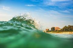 Beautiful colorful ocean wave crashing closing near sand beach Royalty Free Stock Photo