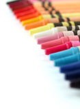 Beautiful colorful pastel(crayon) pencils in a row Stock Photography