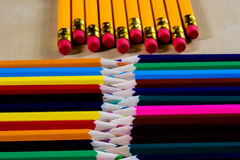 Beautiful and colorful pencil crayons. Bright wooden table. Royalty Free Stock Image