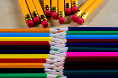 Beautiful and colorful pencil crayons. Bright wooden table. Beautiful and colorful pencil crayons. Wooden table. Black background Royalty Free Stock Images