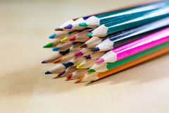 Beautiful and colorful pencil crayons. Bright wooden table. Beautiful and colorful pencil crayons. Wooden table. Black background Royalty Free Stock Photography