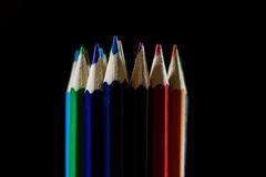 Beautiful and colorful pencil crayons. Bright wooden table. Beautiful and colorful pencil crayons. Wooden table. Black background Stock Photos