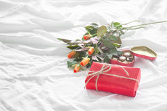 Beautiful colorful pretty gift or present in a paper with chocol Royalty Free Stock Photography