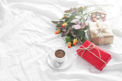 Beautiful colorful pretty gift or present in a paper with chocol Royalty Free Stock Images