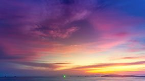 Beautiful colorful purple pink sunset over ocean stock video