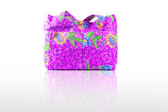 Beautiful and colorful purple printed cloth lady handbag on white backround Royalty Free Stock Photos