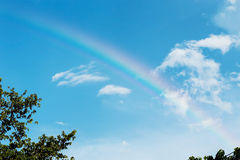 Beautiful colorful rainbow on blue sky Stock Photography