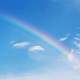 Beautiful colorful rainbow on blue sky Stock Photos