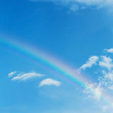 Beautiful colorful rainbow on blue sky Stock Photo