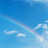 Beautiful colorful rainbow on blue sky Stock Photo