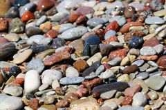 Beautiful colorful rocks on beach. Some beautiful colorful rocks on a beach. Picture has shallow depth of field. Bokeh is very nice. Color is vivid. Rocks are stock photos