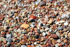 Beautiful colorful rocks on beach. Some beautiful colorful rocks on a beach. Picture has shallow depth of field. Bokeh is very nice. Color is vivid. Rocks are royalty free stock image