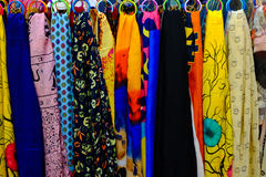 Beautiful colorful scarves hanging in a fashion accessories shop. Close-up of colorful scarves hanging in the market Royalty Free Stock Photos