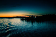 A beautiful, colorful seascape of the Sweden winter eventing from a ferry Royalty Free Stock Photo