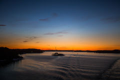 A beautiful, colorful seascape of the Sweden winter eventing from a ferry Stock Photos