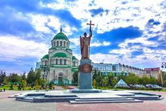 Monument to Saint Vladimir the Baptist and Vladimir Cathedral, Astrakhan, Russia royalty free stock photography