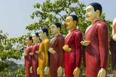 Beautiful colorful statues of buddhist monks at the temple. In Colombo in Sri Lanka royalty free stock image