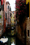 Beautiful colorful street with flowers, canal and boat Royalty Free Stock Image
