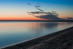 Beautiful colorful summer sea minutes before sunrise landscape with amazing colorful clouds in a blue sky. Stock Image