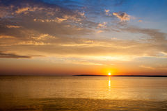 Beautiful colorful summer sea sunrise landscape with amazing colorful clouds in a blue sky. Stock Photo