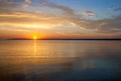 Beautiful colorful summer sea sunrise landscape with amazing colorful clouds in a blue sky. Stock Photography