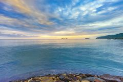 Beautiful colorful sunrise at the shore with cloudy sky. Beautiful colorful sunrise at the calmness sea shore with cloudy sky Royalty Free Stock Images