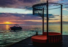 A beautiful colorful sunset on the background of the ocean in a resort in the Maldives Stock Photo
