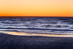 A beautiful, colorful sunset at the Baltic sea beach. Royalty Free Stock Image