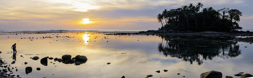 Beautiful colorful sunset near the smal eaxotic island with palm Royalty Free Stock Photo