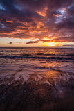 Beautiful Colorful Sunset Over Beach with Clouds Royalty Free Stock Images