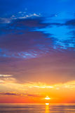 Beautiful colorful sunset over mediterranean sea is reflected in Stock Photos